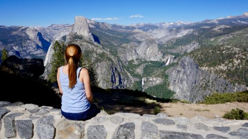 Amy taking in the view of Half Dome from Glacier Point in Yosemite