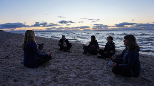 Group meditation on the beach at Findhorn Bay in Scotland
