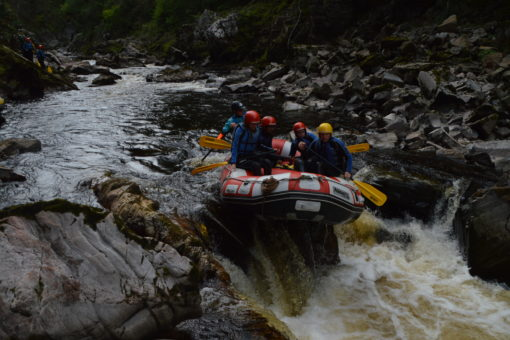 Raft going over rapids on the river Findhorn in Scotland