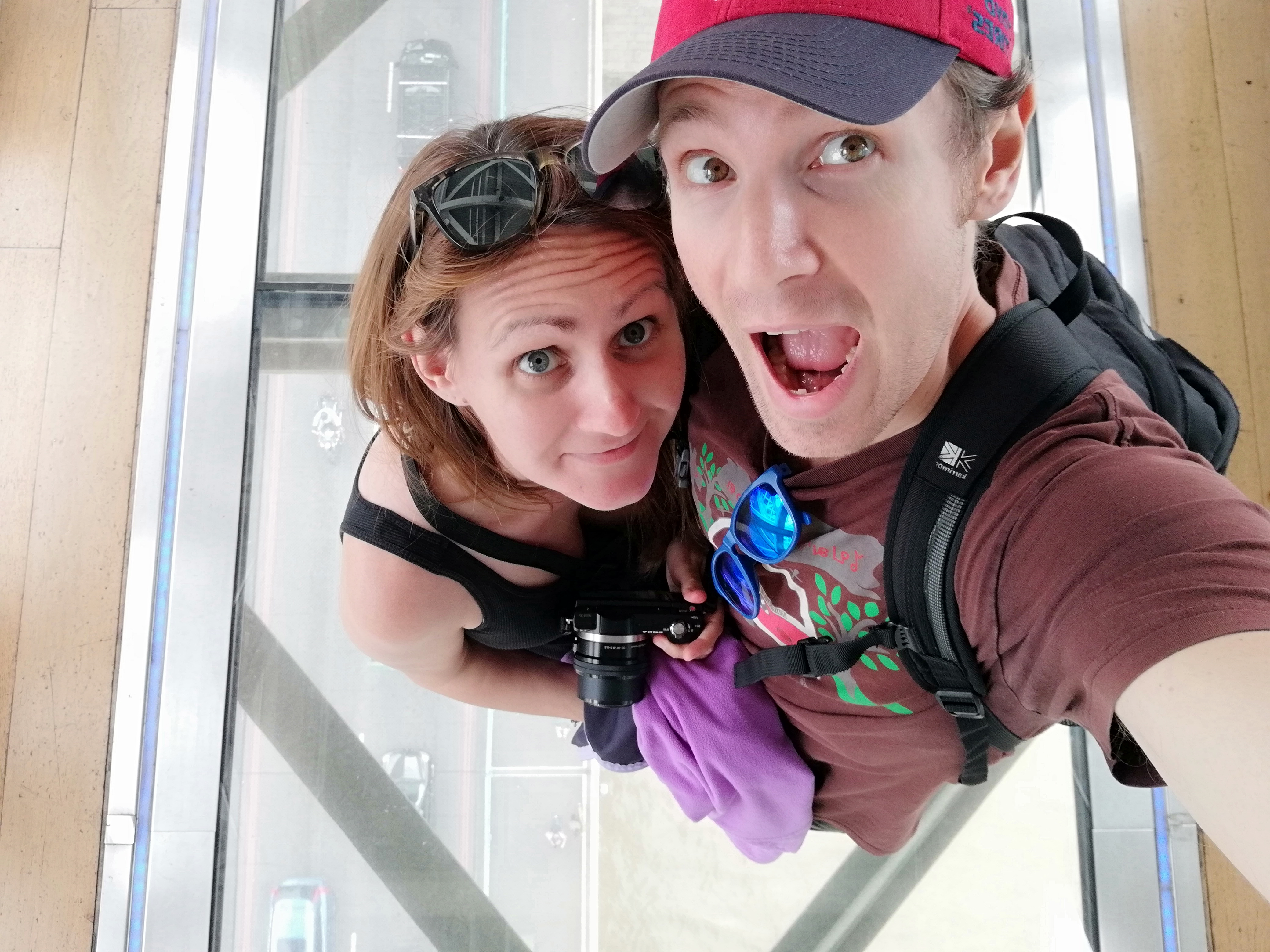 Us on the glass walkway at Tower Bridge in London