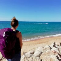 Amy carry the 35L Thule AllTrail backpack by the sea