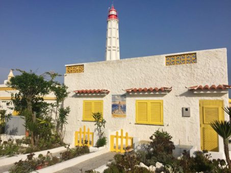 Lighthouse and Portuguese house on an island in the Ria do Formosa, Algarve