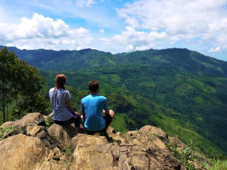 Us at a viewpoint in Ella, Sri Lanka
