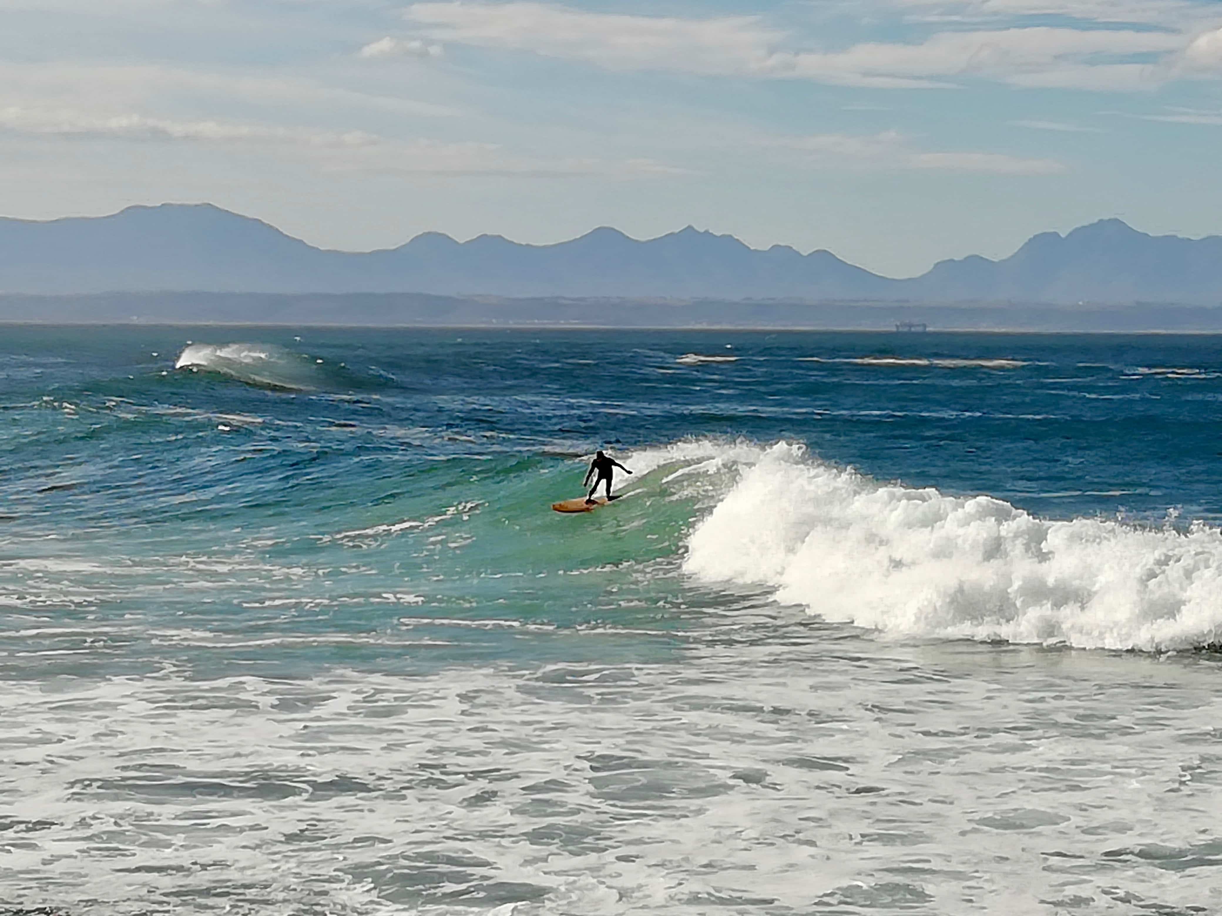 Surfer at Jeffrey's Bay on our Garden Route road trip itinerary, South Africa